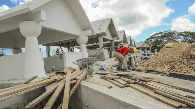 A worker pours mixed concrete into a wooden form as the construction continues on Chamorro-themed structures near the Chamorro Village in Hagåtña on March 29. The buildings are being built in preparation of the 12th Festival of Pacific Arts scheduled for May 22 through June 4. If you wish to volunteer for FestPac, visit your local mayor's office about applications.