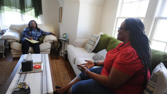 University of Michigan student Brittney Williams, right, talks about stressful challenges with her psychologist, Nina Nabors.