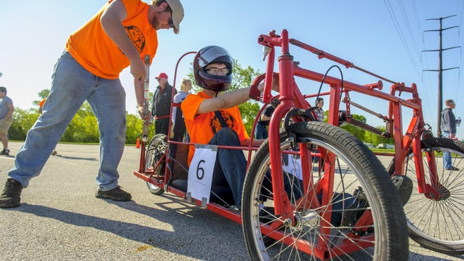 Southeast Polk's Joseph Monahan waits to drive as a crew member starts the engine on car number 6 during the ultimate mileage vehicle competition at the Iowa Industrial Technology Expo May 13.