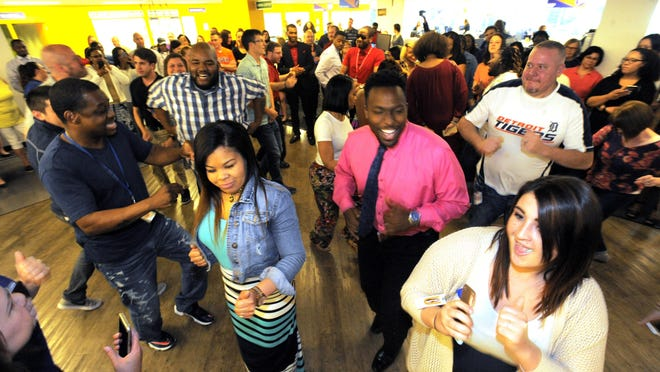 Employees fill the dance floor at United Shore during a dance break at the company headquarters in Troy. (Steve Perez/ The Detroit News)