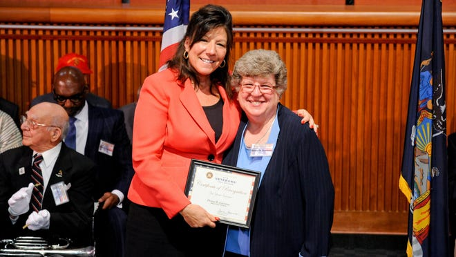 Sen. Sue Serino, left, presents a certificate to Diana B. Gaetano, inducting her into New York State Senate's Veterans Hall of Fame.