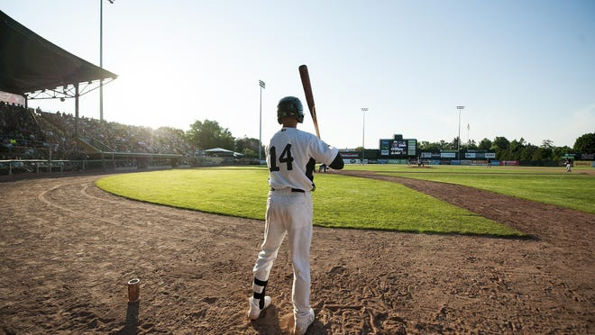 Vermont's Steven Pallares (14) waits on deck during the baseball game between the Connecticut Tigers and the Vermont Lake Monsters at Centennial Field on Sunday in Burlington.