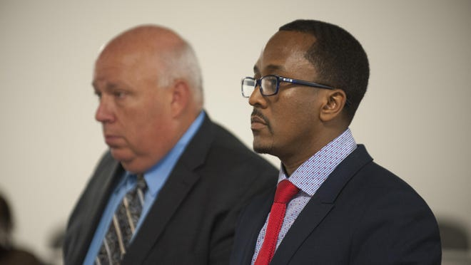 State Rep. Brian Banks of Harper Woods, right, stands with his attorney, Ben Gonek, as he is arraigned in 36th District Court in Detroit on Wednesday.