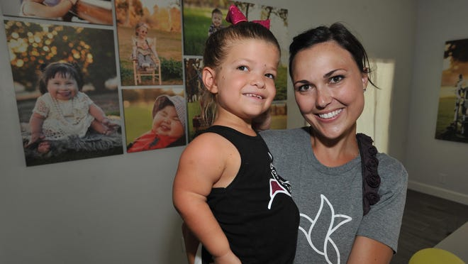Sweet Nectar Society founder Brittany Wilbur and Payton Tumbiolo, 8, at the Sweet Nectar Society's office in Tulare on July 15.
