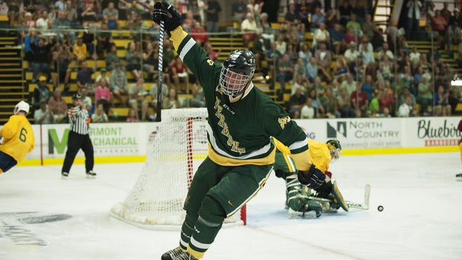 Justin Martin celebrates after scoring a goal during the Greatest Pickup hockey game ever featuring UVM 1996 men's hockey team and alumni at Gutterson Field House on Saturday morning in Burlington.