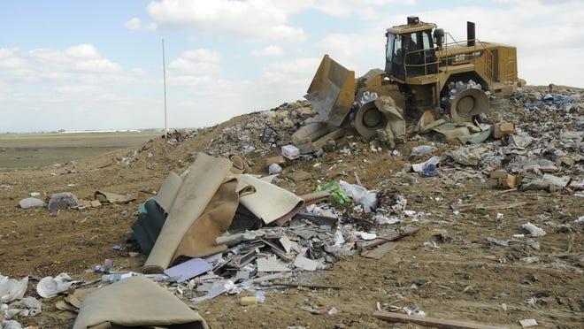 Tractors move around the waste at the Visalia Landfill.