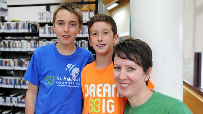 Michael, left, Sean and Shannon Montemurno visit the library at Buena Vista.