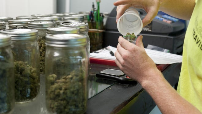Marijuana for sale is weighed at CannaCanHelp Inc. in Goshen. On Tuesday, county supervisors heard from dispensary administrators asking the police makers to reconsider an ordinance banning new and expansion of current locations.