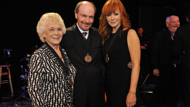 At the 2011 Country Music Hall of Fame Medallion Ceremonies, Jean Shepard, left, Bobby Braddock and Reba McEntire.