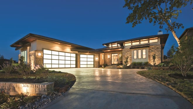 Sleek horizontal lines and a hipped roof show the prairie influence on this modern home.
