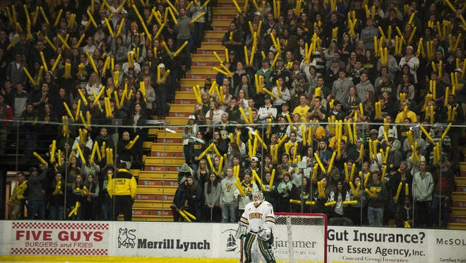 Catamount goalie Mike Santaguida (1) stands in goal as the student section waves thunder sticks during a men's hockey game last season at Gutterson Fieldhouse in Burlington.
