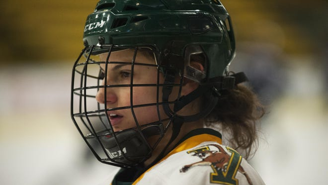 Catamounts forward Amanda Pelkey (21) during warm ups before the start of the women's hockey game between the New Hampshire Wildcats and the Vermont Catamounts at Gutterson Field House in 2015.