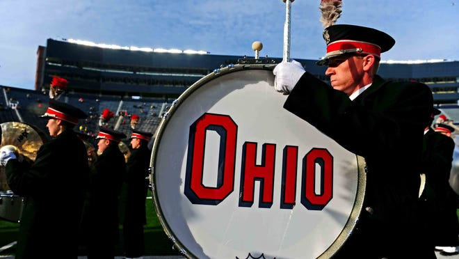 Nov 30, 2013; Ann Arbor, MI, USA; Members of Ohio State Buckeyes marching band on the field prior to the game against the Michigan Wolverines at Michigan Stadium. Mandatory Credit: Andrew Weber-USA TODAY Sports ORG XMIT: USATSI-136386 ORIG FILE ID:  20131126_mje_aw3_1253.jpg