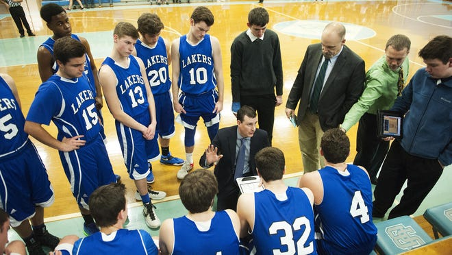 Colchester head coach Joe Maheux talks to the team during a timeout during the boys basketball game between the Colchester Lakers and the South Burlington Rebels at South Burlington High School on Saturday afternoon.