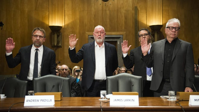 From left, Backpage.com CEO Carl Ferrer, former owner James Larkin, COO Andrew Padilla, and former owner Michael Lacey, are sworn-in on Capitol Hill in Washington, Tuesday, Jan. 10, prior to testifying before the Senate Homeland Security and Governmental Affairs Permanent subcommittee hearing into Backpage.com knowing facilitation of online sex trafficking.