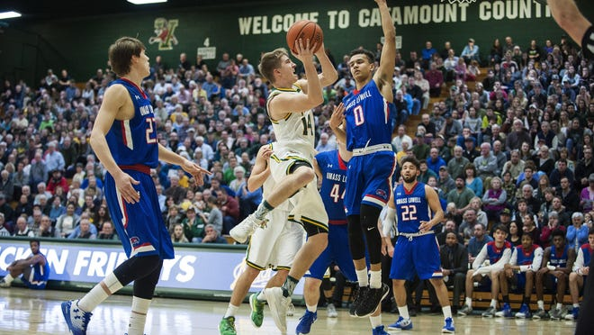Vermont's Cam Ward drives to the hoop against UMass Lowell in Thursday's America East Conference men's basketball game at Patrick Gym.