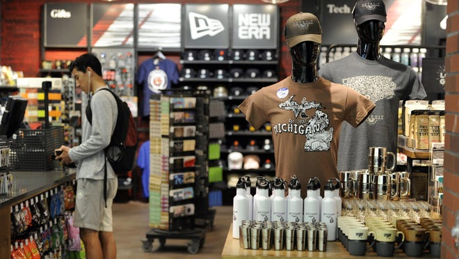 Customers shop at The Detroit News store, located near gate D28 in the North Terminal at Detroit Metro Airport on Friday, May 26, 2017 in Romulus, Mich.