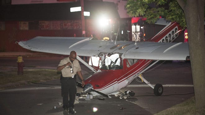 Seth David Killian's airplane lies smashed in the middle of the intersection of Shoemaker and Cooper on the east side of Detroit near I-94 and Gratiot Avenue on June 27, 2016.