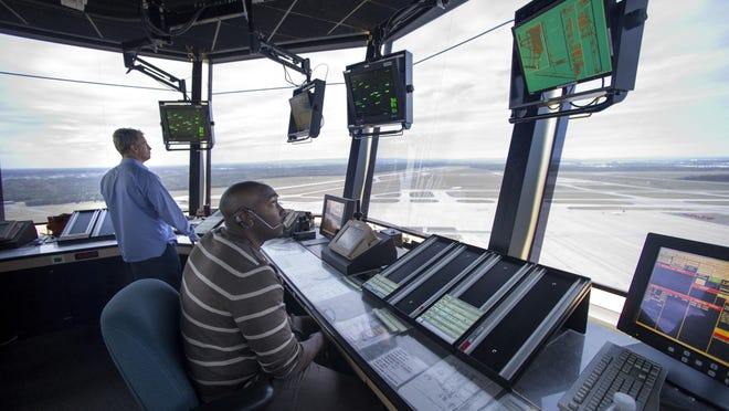 FAA officials work in the Dulles International Airport control tower in Sterling, Va. A plan to privatize air traffic control operations has hit turbulence in the House, raising questions about whether one of President Donald Trump's infrastructure priorities can survive.