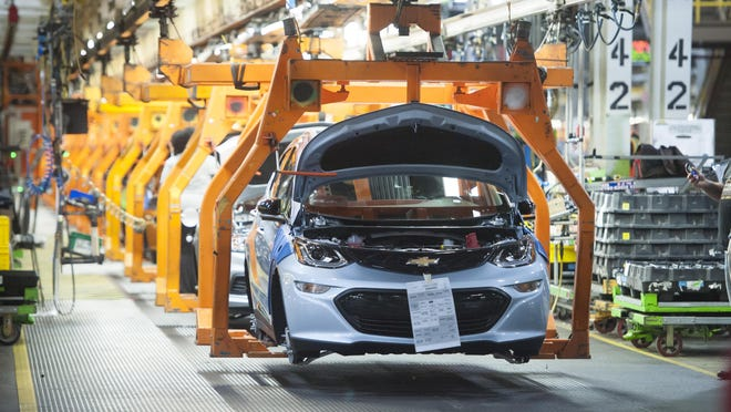 A 2017 Chevrolet Bolt EV makes its way down the assembly line during production of the vehicle at the General Motors assembly plant in Lake Orion in this Dec. 6, 2016 file photo.