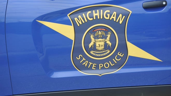 A Michigan State Police trooper has been suspended after a preliminary investigation determined he was the cause of a crash late Friday that left one dead.