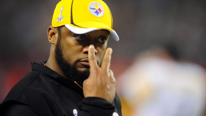 Feb 6, 2011; Arlington, TX, USA; Pittsburgh Steelers head coach Mike Tomlin gestures during the second half of Super Bowl XLV against the Green Bay Packers at Cowboys Stadium.  Mandatory Credit: Mark J. Rebilas-USA TODAY Sports