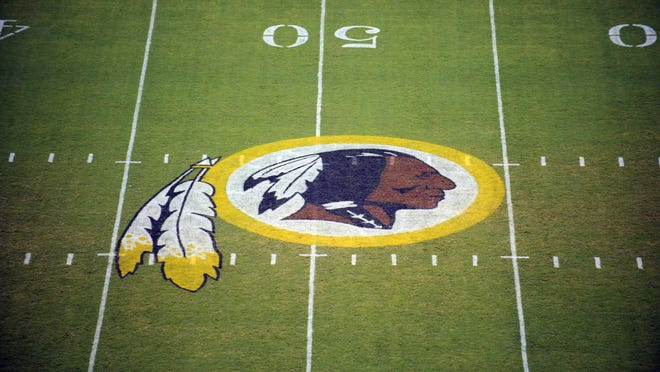 FILE - In this Aug. 28, 2009 file photo, the Washington Redskins logo is shown on the field before the start of a preseason NFL football game against the New England Patriots in Landover, Md.