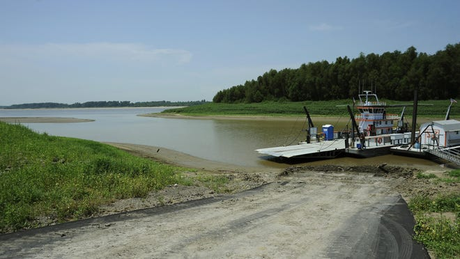 The Hickman Ferry sits idle in 2012 at the Port of Hickman due to low water in the harbor in Hickman, Ky. The ferry, which transports vehicles between Dorena, Mo., and Hickman, has been out of operation for repairs this summer and is expected to resume operations soon.