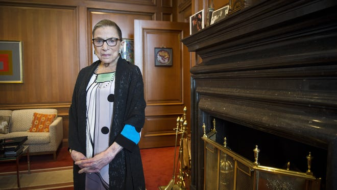 FILE - In this July 31, 2014, file photo, Associate Justice Ruth Bader Ginsburg is seen in her chambers in at the Supreme Court in Washington. The Supreme Court says Ginsburg has died of metastatic pancreatic cancer at age 87.