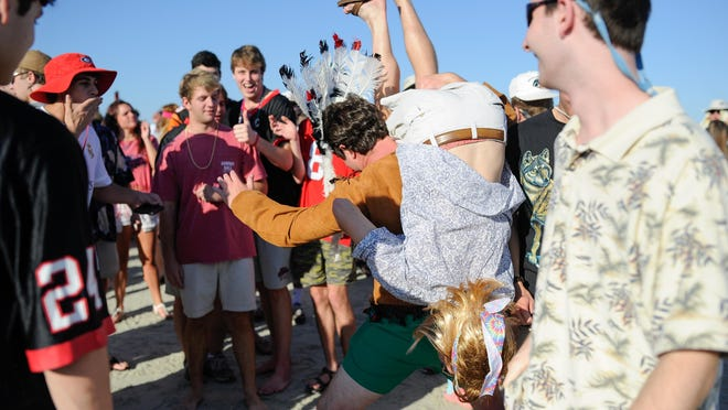 """Georgia fans cavort on """"frat beach"""" at St. Simons Island in October 2015."""