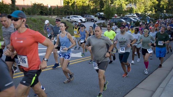 Participants take part in the Apple Festival 5K team and 8K Races Presented by Hunter Subaru last year.