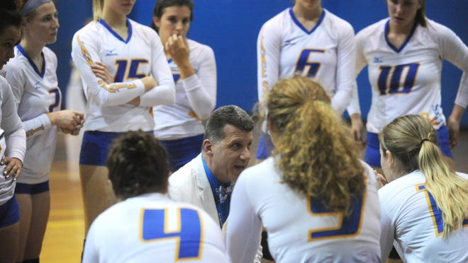 Lake Superior State volleyball coach Dave Schmidlin talks to the team during a home match. The GLIAC annouced that all fall sports comptition has been suspended until January 1, 2021.