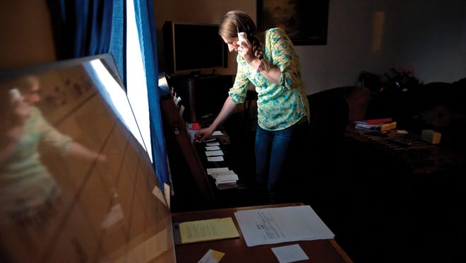Sara Limoge takes a car service request over the phone in the makeshift dispatch office inside Cathy Robar's living room in Colchester.  Big Brother car service has sprung up in the wake of the closure of Benways and Morph Transportation.