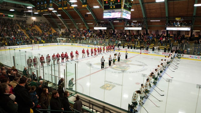 The teams line up to listen to the National Anthem before the start of the men's hockey game between the St. Lawrence Saints and the Vermont Catamounts at Gutterson Field House on Friday night.