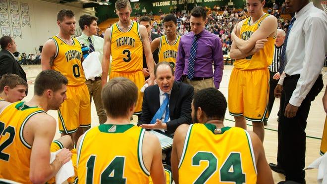 Vermont head coach John Becker talks to his team during a timeout against Yale last season.
