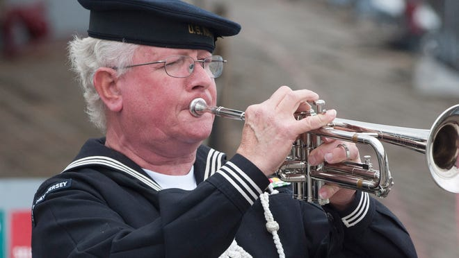 """Bertrand Trottier  plays """"Taps"""" Friday during the 71st anniversary of the commissioning of the USS New Jersey."""