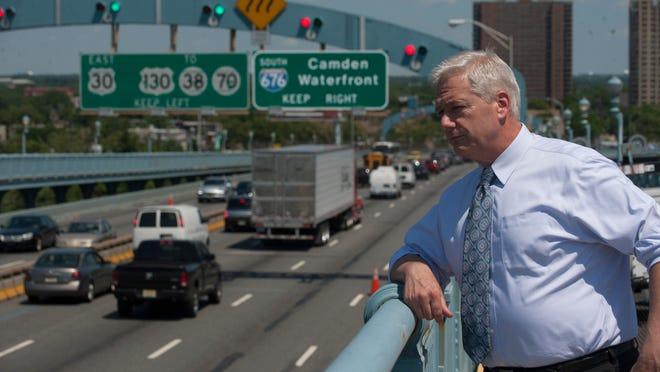 Jon Hanson, CEO of Delaware River Port Authority, walks on the walkway of the Ben Franklin Bridge. Monday, June 16, 2014.