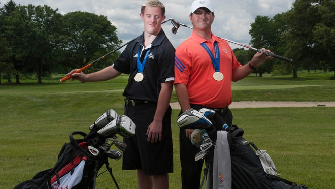 Brad Hennefer and his brother Bob (right) won the National Gold Medal in golf at the N.J. Special Olympics.