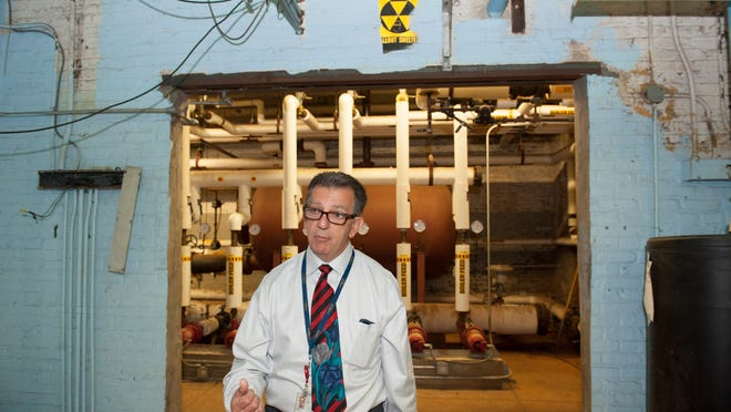 Camden County Emergency Management Coordinator Sam Spino takes us on a tour of the old Fallout Shelter in the Camden City Hall building which now houses HVAC equipment. Wednesday, July 30, 2014.
