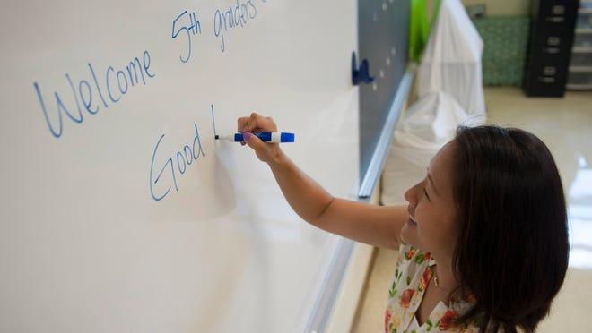 Grace Ahn, 5th grade teacher at Thomas Jefferson Elementary School in Washington Twp., sets up her classroom. Thursday, August 7, 2014.