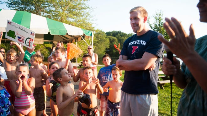 National swimming champion and U.S. record holder Brendan McHugh of Sicklerville speaks to children at his hometown swim club Greenwood Park in Washington Township on Thursday. He was a standout at St. Augustine Prep and the University of Pennsylvania.