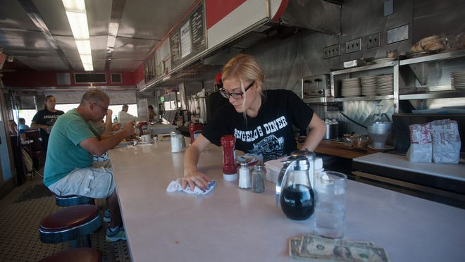Angelo's Diner waitress, Jodie Justice wipes the counter during breakfast hour in Glassboro. The diner received help and support from the community and other business around the town after suffering from small fire.