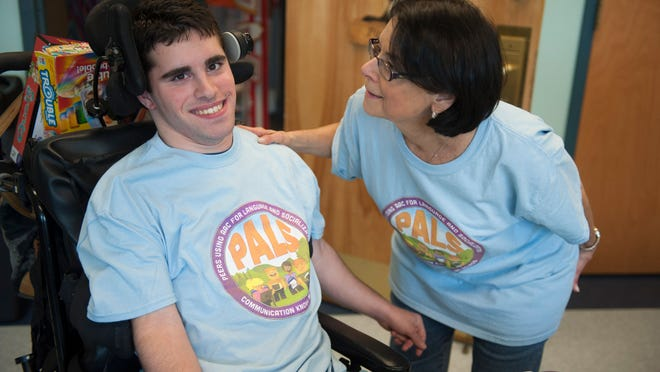 Speech therapist Ann Simon interacts with Nick Grasso during the PALS program at the Jewish Community Center in Cherry Hill. PALS gives nonverbal teens an opportunity to interact with each other while enjoying arts and crafts, music, drama, swimming and games.