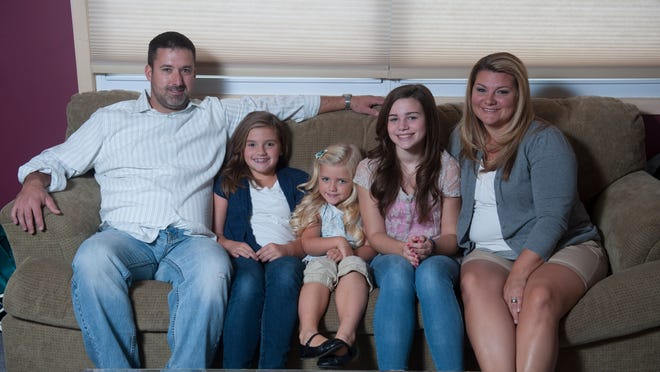 The McLaughlin family, Kevin, Julia 9, Tristyn 5, Ryleigh 13, and Sherrie for story about kids missing school for family trips. Thursday, September 25, 2014.