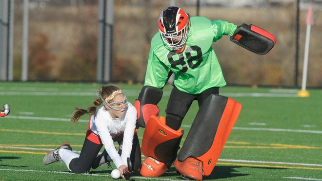 Ocean City's Maria Farnan and Warren Hills goalie Jackie de Raismes battle for the ball during the Group 3 state title Saturday.