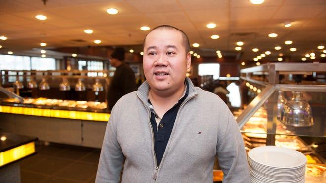 Zhenghai Zheng, co-owner of Ichiban Buffett in Chery Hill for storefront. Wednesday, January 7, 2014.