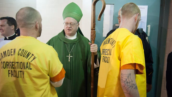 Bishop Dennis Sullivan greets inmates at the Camden County Correctional Facility following a special mass there. Thursday, January 15, 2015.