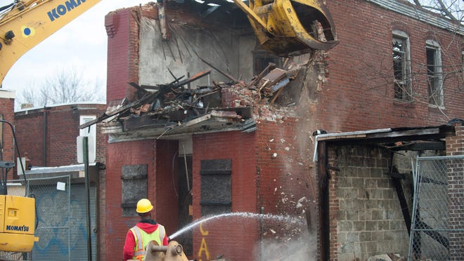 Demolition of 1510 Louis St. in Camden, the first of 62 abandoned properties scheduled to get torn down. Tuesday, January 20, 2015.