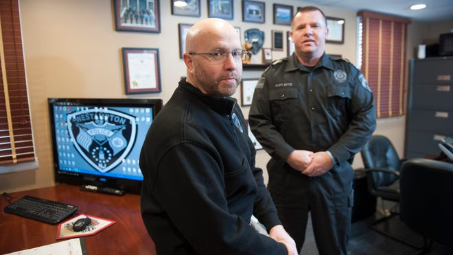 Outgoing Westampton Police Chief Rick Smith (left) talks with incoming chief, Captain Joseph Otto. Wednesday, January 21, 2015.