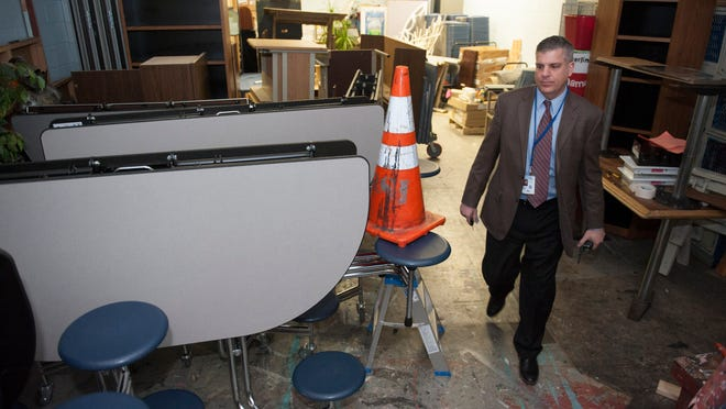 Superintendent and principal at Sterling High School Mark Napoleon walks through a catch-all storage area in the school.